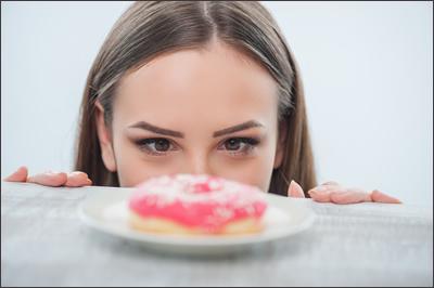Woman Staring at Doughnut