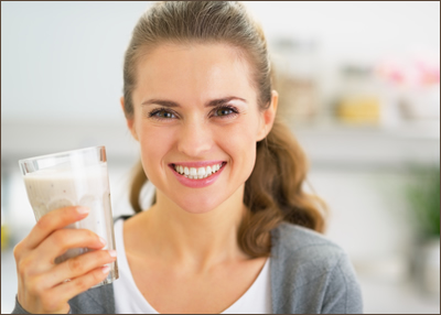 Smiling woman holding shake